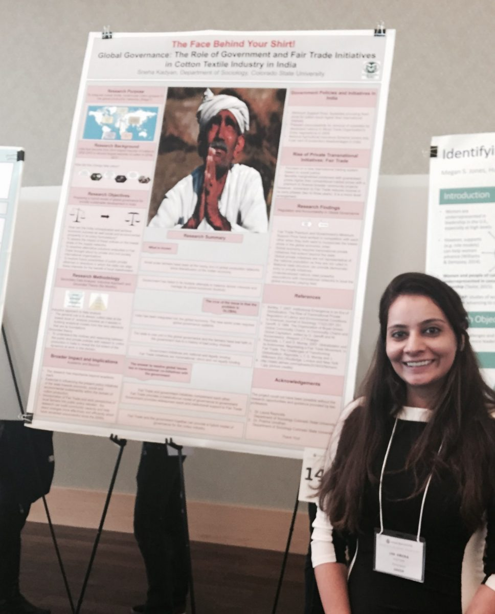 Sneha Kadyann with her poster at the Grad Showcase