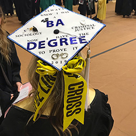 Sociology message atop grad hat