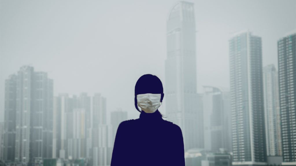 woman in mask on street