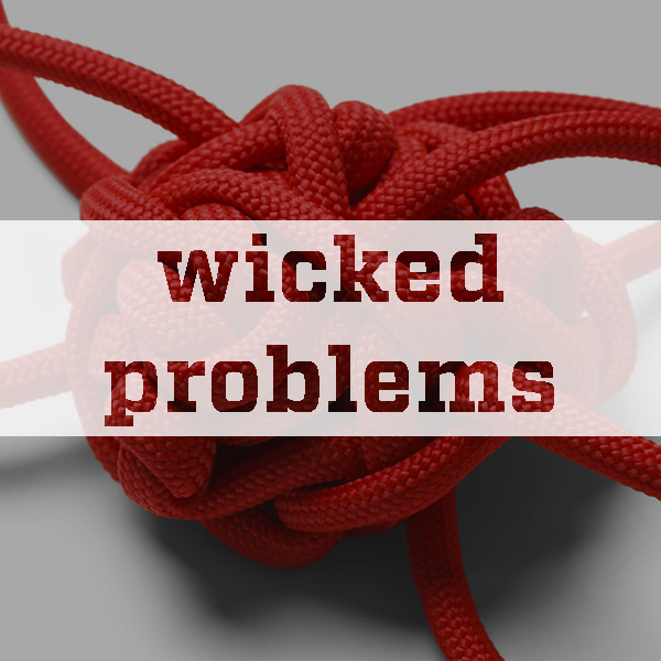 knot with wicked problems text overlay