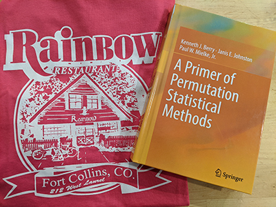 Dr. Berry's book next to Rainbow tshirt